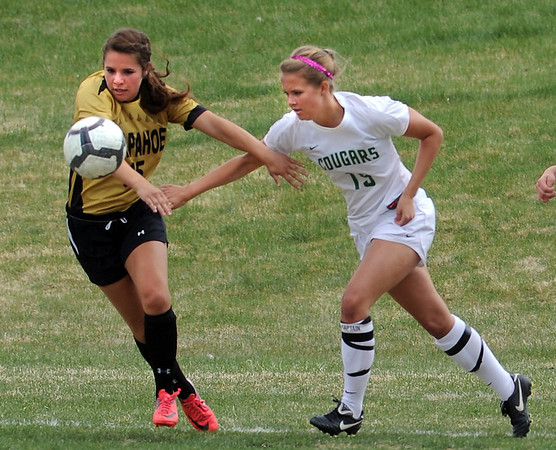 "Lauren Conley, left, of Arapahoe, and Samantha Shaner of Niwot, try to get control of the ball on Saturday.<br /> For more photos of the game, go to  <a href=""http://www.dailycamera.com"">http://www.dailycamera.com</a><br /> Cliff Grassmick / April 14, 2012"