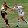 """Lauren Conley, left, of Arapahoe, and Samantha Shaner of Niwot, try to get control of the ball on Saturday.<br /> For more photos of the game, go to  <a href=""""http://www.dailycamera.com"""">http://www.dailycamera.com</a><br /> Cliff Grassmick / April 14, 2012"""
