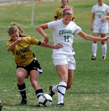 "Andrea Lewis, left, of Arapahoe, and Samantha Shaner of Niwot, battle for control.<br /> For more photos of the game, go to  <a href=""http://www.dailycamera.com"">http://www.dailycamera.com</a><br /> Cliff Grassmick / April 14, 2012"