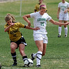 """Andrea Lewis, left, of Arapahoe, and Samantha Shaner of Niwot, battle for control.<br /> For more photos of the game, go to  <a href=""""http://www.dailycamera.com"""">http://www.dailycamera.com</a><br /> Cliff Grassmick / April 14, 2012"""