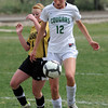 "Hannah Driscoll (12) of Niwot controls the ball past the Arapahoe defender.<br /> For more photos of the game, go to  <a href=""http://www.dailycamera.com"">http://www.dailycamera.com</a><br /> Cliff Grassmick / April 14, 2012"