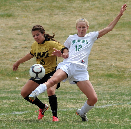 """Lauren Conley, left, of Arapahoe, and Hannah Driscoll of Niwot, try to get control of the ball on Saturday.<br /> For more photos of the game, go to  <a href=""""http://www.dailycamera.com"""">http://www.dailycamera.com</a><br /> Cliff Grassmick / April 14, 2012"""