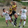 """Stacey Lukasiewicz, center,  of Arapahoe, tries to keep the ball from Maria Fayeulle (15)  and Kylie Fischer, both of Niwot.<br /> For more photos of the game, go to  <a href=""""http://www.dailycamera.com"""">http://www.dailycamera.com</a><br /> Cliff Grassmick / April 14, 2012"""
