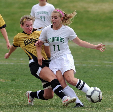 """Kylie Fischer, right, of Niwot, has the ball kicked away by  Stella Norman of Arapahoe.<br /> For more photos of the game, go to  <a href=""""http://www.dailycamera.com"""">http://www.dailycamera.com</a><br /> Cliff Grassmick / April 14, 2012"""
