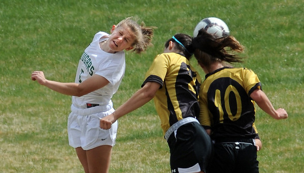 """Kelley Sheeran, left, of Niwot, uses her head to try to score on Arapahoe on Saturday.<br /> For more photos of the game, go to  <a href=""""http://www.dailycamera.com"""">http://www.dailycamera.com</a><br /> Cliff Grassmick / April 14, 2012"""