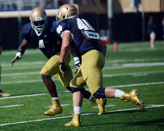 HALEY WARD | THE GOSHEN NEWS<br /> Linebacker Tevon Coney goes to tackle linebacker Kier Murphy during Notre Dame football practice Wednesday.