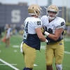 HALEY WARD | THE GOSHEN NEWS<br /> Tight end Nic Weishar 82 blocks tight end Ben Suttman (84) during Notre Dame football practice Saturday.