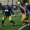 HALEY WARD | THE GOSHEN NEWS<br /> Linebacker Asmar Bilal goes to tackle linebacker Brandon Hutson during a drill at Notre Dame football practice Wednesday.
