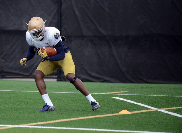 HALEY WARD | THE GOSHEN NEWS<br /> Running back Josh Adams runs drills during Notre Dame football practice Saturday.