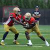 HALEY WARD | THE GOSHEN NEWS<br /> Quarterback Malik Zaire hands off the ball to running back Dexter Williams while running drills at Notre Dame football practice Saturday.