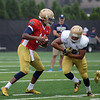 HALEY WARD | THE GOSHEN NEWS<br /> Quarterback DeShone Kizer fakes handing off the ball to running back Josh Anderson while running drills during Notre Dame football practice Saturday.