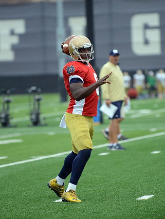 HALEY WARD | THE GOSHEN NEWS<br /> Quarterback Malik Zaire passes the ball during Notre Dame football practice Saturday.