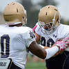 HALEY WARD | THE GOSHEN NEWS<br /> Tight end Durham Smythe (80) blocks tight end Alize Jones (10) during Notre Dame football practice Saturday.