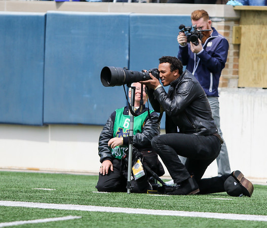 CHAD WEAVER | THE GOSHEN NEWS<br /> Former Notre Dame quarterback DeShone Kizer gets a look at the action through a photographer's camera during the first half of Saturday's Blue-Gold game at Notre Dame Stadium.