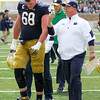 CHAD WEAVER | THE GOSHEN NEWS<br /> Offensive line coach Harry Hiestand talks with senior offensive lineman Mike McGlinchey as they walk off the field for halftime of Saturday's Blue-Gold game at Notre Dame Stadium.