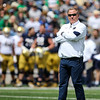 CHAD WEAVER | THE GOSHEN NEWS<br /> Notre Dame head coach Brian Kelly looks on during the first half of Saturday's Blue-Gold game at Notre Dame Stadium.