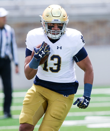 CHAD WEAVER | THE GOSHEN NEWS<br /> Notre Dame senior tight end Tyler Luatua runs after making a catch during the second half of Saturday's Blue-Gold Game at Notre Dame Stadium.