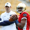 CHAD WEAVER | THE GOSHEN NEWS<br /> Former Notre Dame quarterback and first-year quarterbacks coach Tom Rees looks on as quarterback Brandon Wimbush warms up prior to the start of Saturday's Blue-Gold game at Notre Dame Stadium.