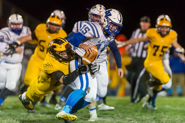 Panthers linebacker Danny Gregorich (24) wraps up Lancers quarterback Braxton Sauer (15) in the backfield in the first quarter. Pioneer defeated LaVille 38-0 in regional football action at the Pit on Friday night. Fran Ruchalski | Pharos-Tribune