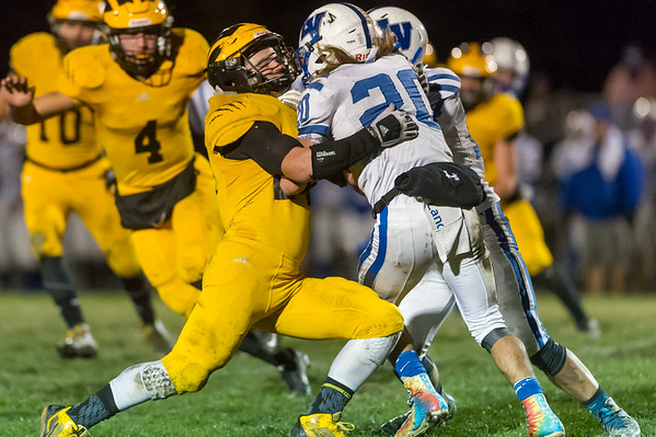 Panthers linebacker Danny Gregorich (24) brings to a halt Lancers running back Dakota Figg (20) in the second quarter. Pioneer defeated LaVille 38-0 in regional football action at the Pit on Friday night. Fran Ruchalski | Pharos-Tribune