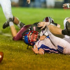 Comets quarterback Brandon Kinser (9) was unable to keep control of the football while he was being tackled and fumbles in the first half. Winamac went on to defeat Caston by a score of 47-8. Fran Ruchalski | Pharos-Tribune