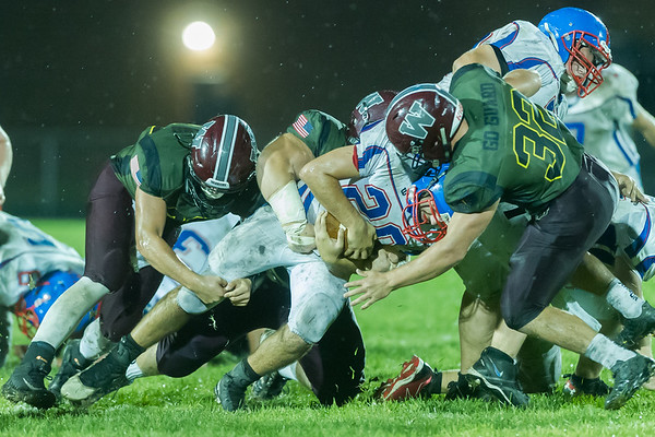 Comets Brady Hartman (20) stretches out for extra yards but his forward progress is stopped in the second half. Winamac went on to defeat Caston by a score of 47-8. Fran Ruchalski | Pharos-Tribune