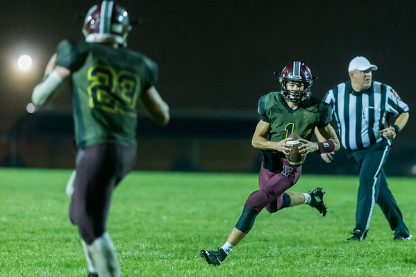 Warriors quarterback Jeb Smith (1) scrambles in the fourth quarter and runs in for his third touchdown of the night. Winamac went on to defeat Caston by a score of 47-8. Fran Ruchalski   Pharos-Tribune