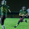 Warriors quarterback Jeb Smith (1) scrambles in the fourth quarter and runs in for his third touchdown of the night. Winamac went on to defeat Caston by a score of 47-8. Fran Ruchalski | Pharos-Tribune