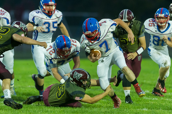 Comets Tayt Cowell (7) tries to run  around Warrior Austin Brandt (23) who wraps his arms around the runner's legs in the first half. Winamac went on to defeat Caston by a score of 47-8. Fran Ruchalski   Pharos-Tribune