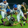 Comets Tayt Cowell (7) tries to run  around Warrior Austin Brandt (23) who wraps his arms around the runner's legs in the first half. Winamac went on to defeat Caston by a score of 47-8. Fran Ruchalski | Pharos-Tribune