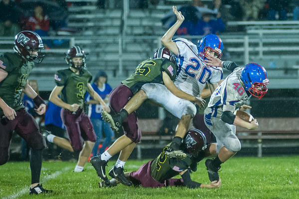 Warriors Trent Fox (35) and Ethan Rogers (32) tie up Comets Brady Hartman (20) and Kasey Ault (40) on a kick run back in the second half. Winamac went on to defeat Caston by a score of 47-8. Fran Ruchalski   Pharos-Tribune