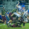 Warriors Trent Fox (35) and Ethan Rogers (32) tie up Comets Brady Hartman (20) and Kasey Ault (40) on a kick run back in the second half. Winamac went on to defeat Caston by a score of 47-8. Fran Ruchalski | Pharos-Tribune