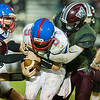 Comets quarterback Brandon Kinser (9) tries hard to keep control of the ball as several Warriors try to rip it from his arms in the first half. Winamac went on to defeat Caston by a score of 47-8. Fran Ruchalski | Pharos-Tribune