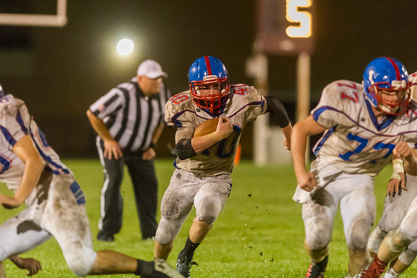 Comets Kasey Ault (40) runs through the line in the second half. Winamac went on to defeat Caston by a score of 47-8. Fran Ruchalski   Pharos-Tribune
