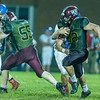Warriors running back Ethan Rogers (32) breaks a run for a touchdown in the second half. Winamac went on to defeat Caston by a score of 47-8. Fran Ruchalski | Pharos-Tribune