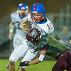 Comets Kaleb Conrad (10) runs hard but is wrapped up by Warriors Harley Pugh (18) in the first half. Winamac went on to defeat Caston by a score of 47-8. Fran Ruchalski | Pharos-Tribune