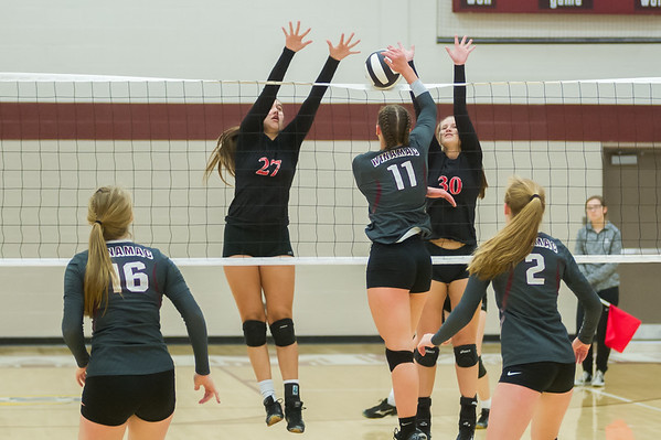 Lady Warrior Isabelle Dotlich (11) puts the ball between Lady Berries Brooke Veasey (27) and Lauren Shilts (30) in volleyball action at Winamac on Thursday night. Fran Ruchalski | Pharos-Tribune