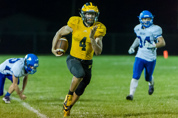 Panthers quarterback Jack Burley Kiser (4) runs in his third touchdown of the night as Pioneer took on Triton at The Pit on Thursday evening. Fran Ruchalski   Pharos-Tribune