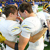 Pioneers' Calahan Kindley and Jack Kiser hug after they beat North Vermillion in the Class A State Finals 60-0 on Nov. 24, 2018 at Lucas Oil Stadium.<br /> Tim Bath | Kokomo Tribune