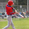 Caston Comets infielder Kade Zeider (4) hits the ball during the first inning of a game between the Rochester Zebras and Caston Comets on Saturday, April 17, 2021 in Rochester.