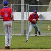 Caston Comets infielder Joey Spin (2) watches as outfielder Carter See (8) makes a catch during the third inning of a game between the Rochester Zebras and Caston Comets on Saturday, April 17, 2021 in Rochester.