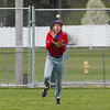 Caston Comets outfielder Carter See (8) catches a pop up during the third inning of a game between the Rochester Zebras and Caston Comets on Saturday, April 17, 2021 in Rochester.