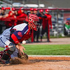 Lewis Cass Kings' Keigan Albright (5) blocks a pitch in the dirt during the second inning of a game between the Lewis Cass Kings and Taylor Titans on Friday, May 7, 2021 in Walton.