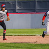 Taylor Titans infielder Michael Pemberton (8) chases Lewis Cass Kings' Adam Bandelier (17) during the first inning of a game between the Lewis Cass Kings and Taylor Titans on Friday, May 7, 2021 in Walton.