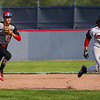 Lewis Cass Kings' Adam Bandelier (17) runs back to first as Taylor Titans infielder Michael Pemberton (8) chases him during the first inning of a game between the Lewis Cass Kings and Taylor Titans on Friday, May 7, 2021 in Walton.