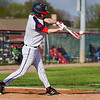 """Lewis Cass Kings' Jack """"The Ripper"""" Salyers (8) hits the ball during the second inning of a game between the Lewis Cass Kings and Taylor Titans on Friday, May 7, 2021 in Walton."""