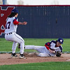 Lewis Cass Kings' Kaine Fowler (4) tries tog et control of a ground ball as Adam Bandelier (17) comes to assist during the second inning of a game between the Lewis Cass Kings and Tipton Blue Devils on Wednesday, April 14, 2021 in Walton.