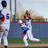 Lewis Cass Kings' Adam Bandelier (17) catches a line drive as a Tipton Blue Devils player runs past him during the first inning of a game between the Lewis Cass Kings and Tipton Blue Devils on Wednesday, April 14, 2021 in Walton.