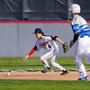 Lewis Cass Kings' Kaine Fowler (4) chases a ball as a Tipton Blue Devils runner heads to second base during the first inning of a game between the Lewis Cass Kings and Tipton Blue Devils on Wednesday, April 14, 2021 in Walton.