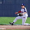 Lewis Cass Kings' Kaine Fowler (4) goes to grab a ground ball during the second inning of a game between the Lewis Cass Kings and Tipton Blue Devils on Wednesday, April 14, 2021 in Walton.